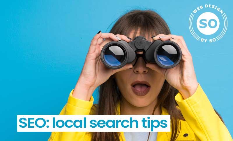 local search tips - seo - girl searching with binoculars